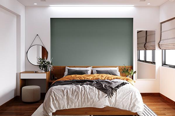 Mảng tường sát đầu giường được thiết kế lõm vào, sơn xám thanh lịch tạo thành điểm nhấn nổi bật, thu hút giữa tông nền trắng thanh thuần