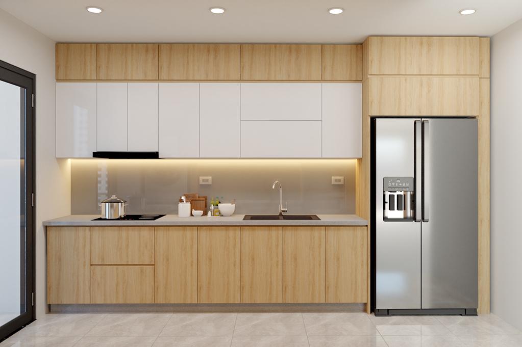 Tủ bếp Acrylic trên màu trắng sáng bóng kết hợp tủ bếp dưới màu nâu vân gỗ sáng tạo cảm giác không gian bếp được nới rộng ra.