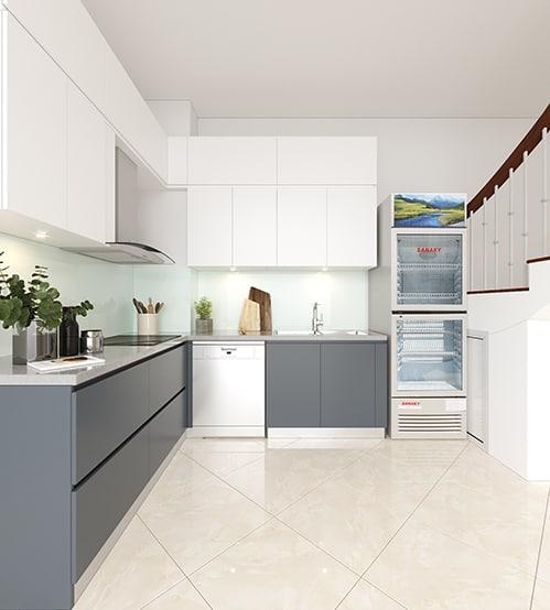 Tận dụng không gian nhỏ chỉ 6m2 bên cạnh cầu thang, thiết kế tối giản phối hợp 2 gam màu trung tính là trắng và ghi xám giúp căn bếp trông luôn mới và thoáng đãng.