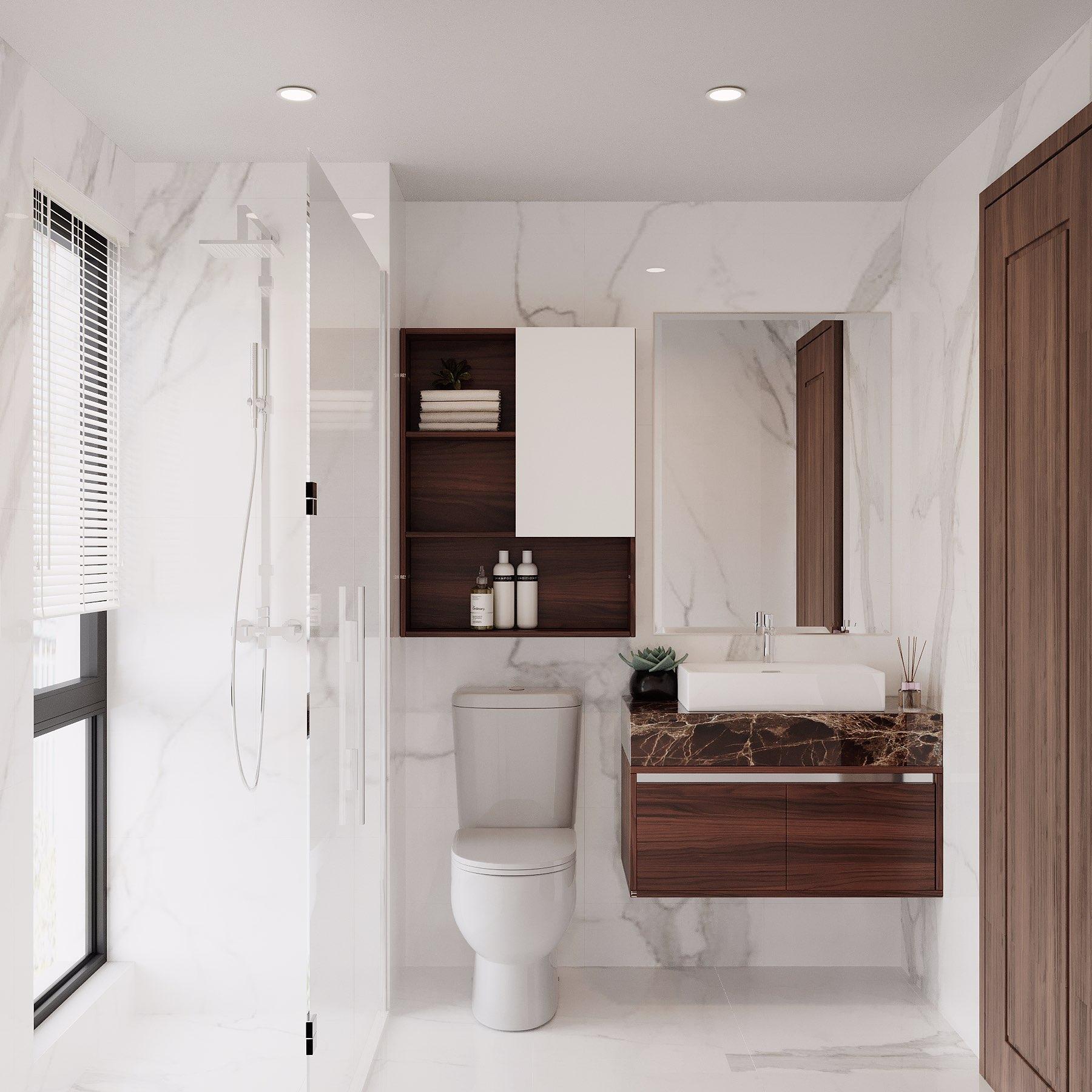 Một phòng vệ sinh nhỏ có đầy đủ bồn rửa mặt, bồn cầu, vòi tắm hoa sen, tủ đồ được xây dựng ngay trong phòng ngủ để gia chủ sinh hoạt thuận tiện hơn