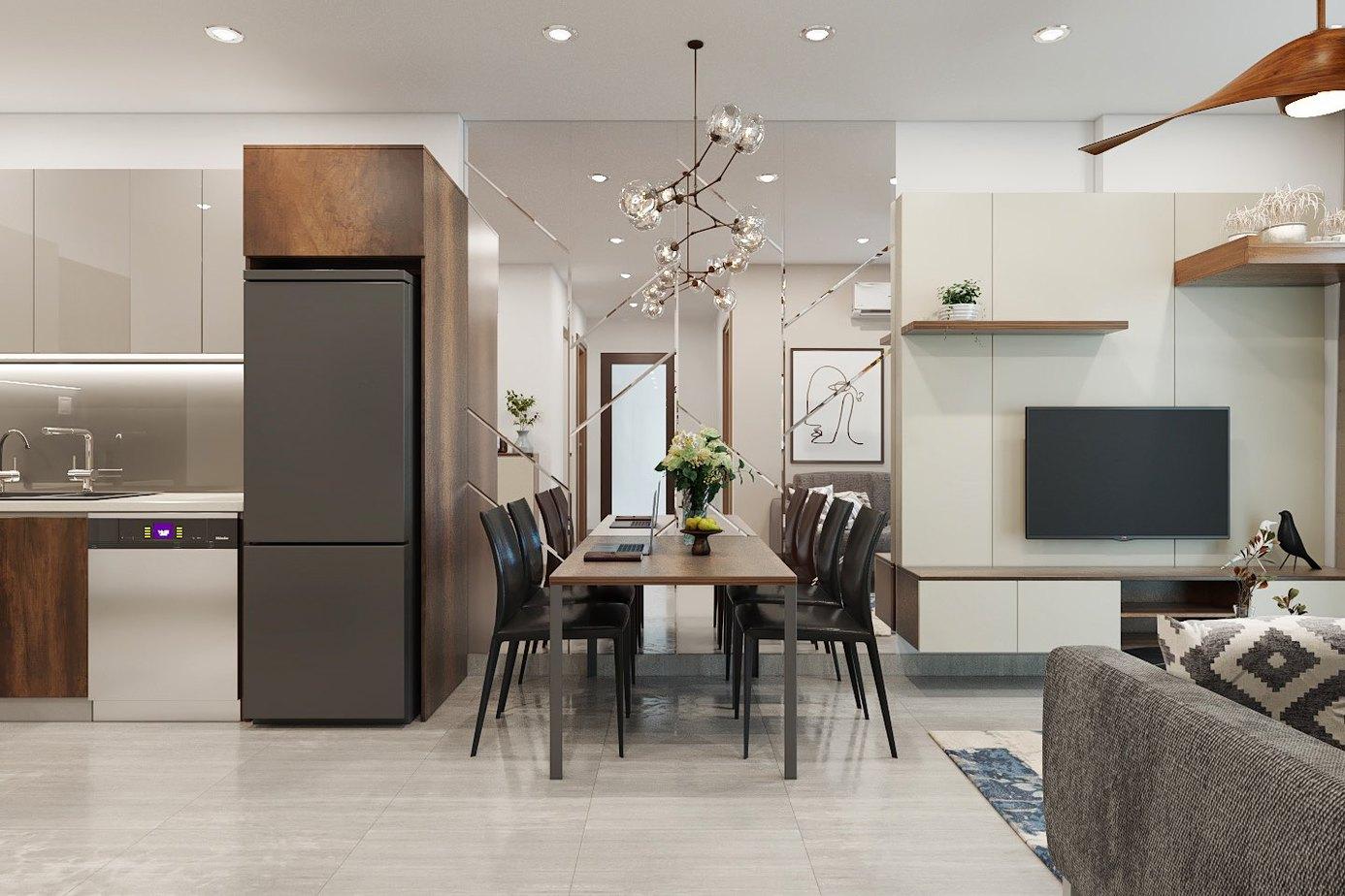 Tận dụng thiết kế tủ bếp để thành chiếc vách ngăn cách khu vực bếp nấu và bàn ăn giúp tiết kiệm không gian một cách tối ưu.