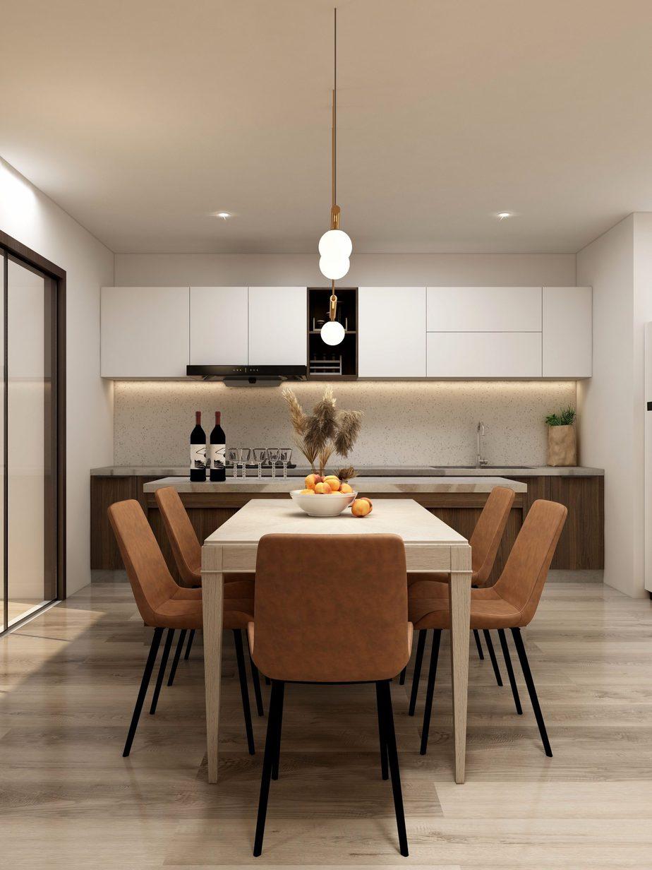 Quầy bar được đặt giữa bàn ăn và bếp nấu tạo ra sự ngăn cách tiện lợi mà không làm mất tính thẩm mỹ của căn phòng.