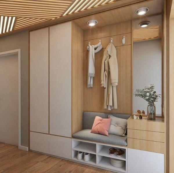 Tủ âm tường được tích hợp thêm ghế sofa nhỏ và bàn trang điểm giúp tối ưu hóa không gian cho căn phòng.