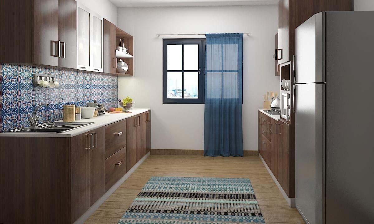 Tủ bếp chung cư song song này có điểm nhấn ở sự kết hợp với gạch ốp 3D Mexico họa tiết độc đáo. Tủ được phủ lớp màu nâu gỗ trầm mang lại không gian nhà bếp ấm cúng và thân thiện.