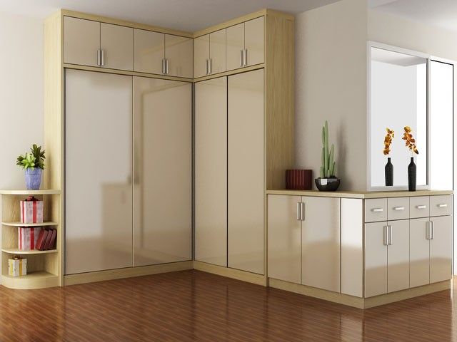 Tủ quần áo chữ L cao kịch trần kết hợp với chiếc tủ ngang mang lại sự đồng nhất, gọn gàng cho căn phòng.