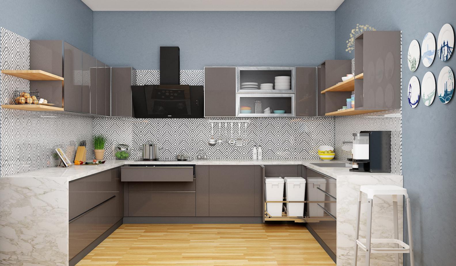 Tủ bếp chữ U đồng bộ về màu sắc với gam màu xám đậm sang sạch. Kết hợp những họa tiết trắng đen ốp tường bếp, tạo nên không gian bếp ấn tượng, tạo hứng thú nấu nướng rất hiệu quả.