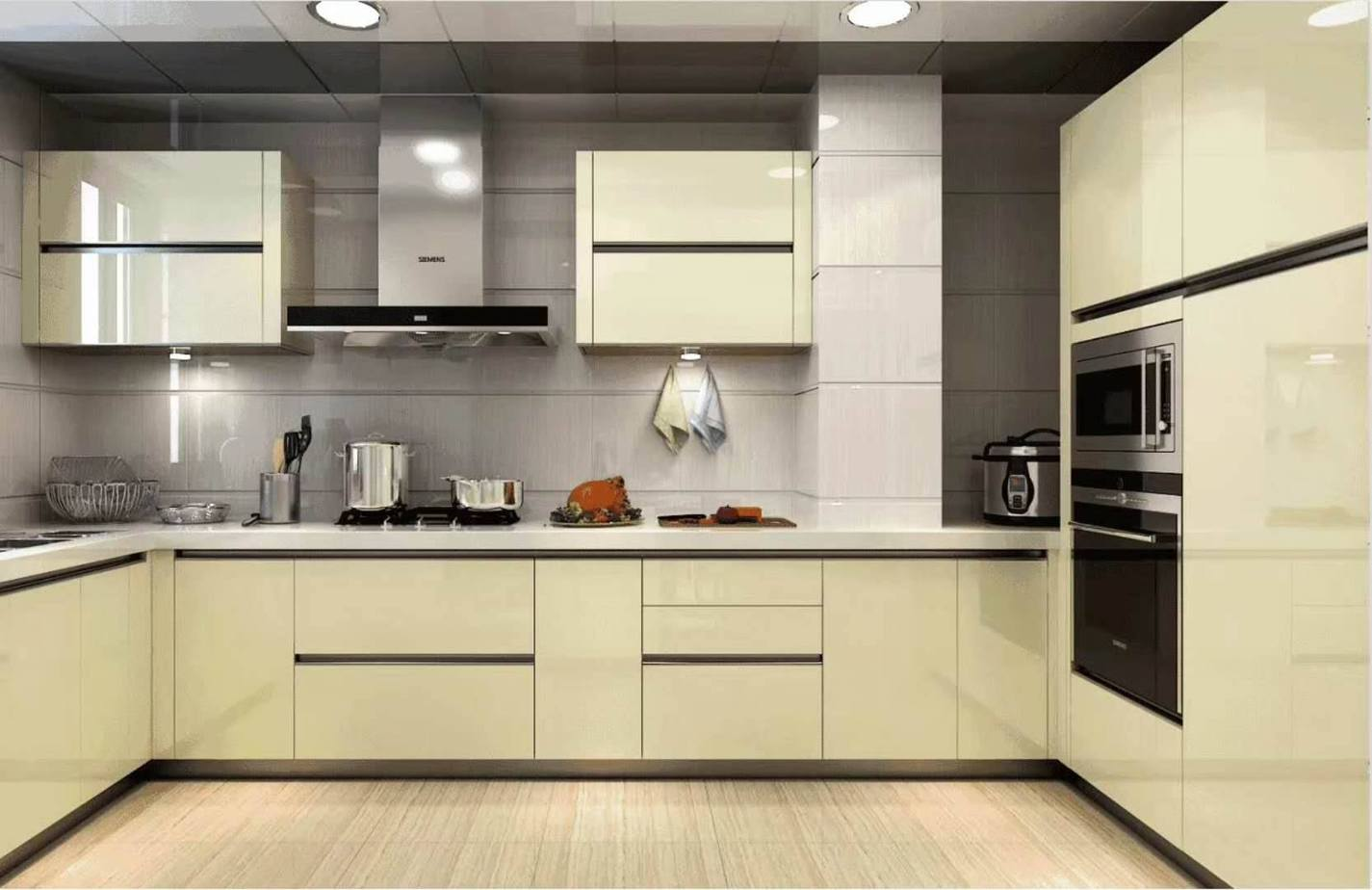 Gam màu trắng sữa của tủ bếp chữ U dưới ánh đèn của hệ thống đèn chiếu sáng kết hợp hài hòa, mang đến cảm giác dễ chịu, ấm cúng cho không gian bếp.