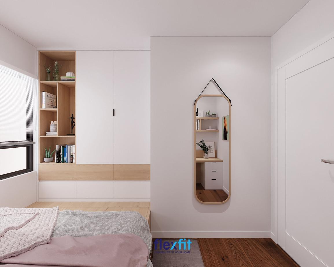 Mẫu tủ quần áo 2 buồng 1m6 thiết kế âm tường và kịch trần tiết kiệm diện tích. Sản phẩm được tích hợp kệ chứa cùng nhiều ngăn kéo và cùng hệ thống liền với giường ngủ vô cùng tiện ích.