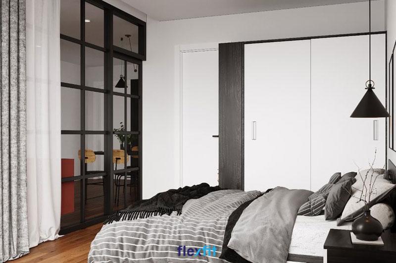 Mẫu tủ quần áo 2m có thiết kế tối giản, tinh tế, sử dụng 2 tông màu cơ bản là trắng và đen vân gỗ, đồng bộ với phong cách nội thất chung của không gian phòng ngủ. Tủ có kích thước nhỏ gọn, sử dụng cánh lùa tiện lợi, tiết kiệm diện tích.