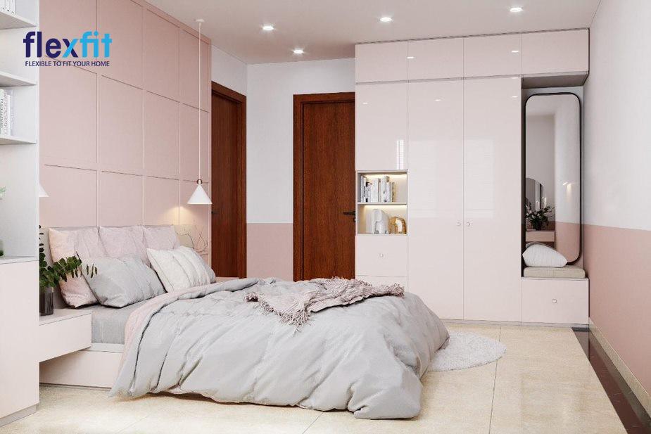 Mẫu tủ trên có cánh tủ phủ chất liệu sáng bóng phản chiếu ánh sáng tốt, giúp căn phòng đẹp bừng sáng. Thiết kế tủ tích hợp gương toàn thân tiện dụng và xen kẽ hộc không cánh để bày vật trang trí.