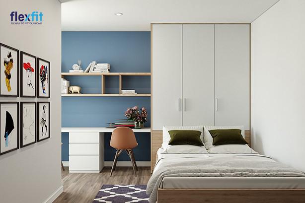 Mẫu tủ quần áo 3 cánh này được thiết kế tích hợp cùng hệ thống giường ngủ và bàn làm việc, giúp tiết kiệm tối đa không gian. Tủ phối màu trắng và màu vân gỗ sáng tương phản với mảng tường xanh giúp căn phòng thêm sinh động mà vẫn hài hoà.