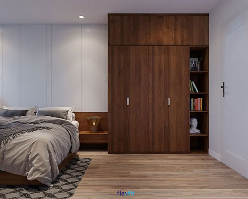 Mang đậm phong cách Bắc Âu cổ điển, với màu vân gỗ trầm, tủ quần áo 4 cánh 3m này mang lại sự ấm cúng, sang trọng cho căn phòng. Phần kệ sách được bố trí ngoài không chỉ tiện lợi mà còn giúp tăng tính thẩm mỹ cho căn phòng.