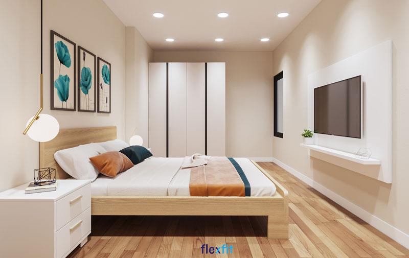 Tủ quần áo 4 buồng màu trắng với đường nẹp tủ màu đen nổi bật. Không gian phòng với sự hiện diện của mẫu tủ hài hòa về màu sắc này vừa tiện nghi, vừa hiện đại.