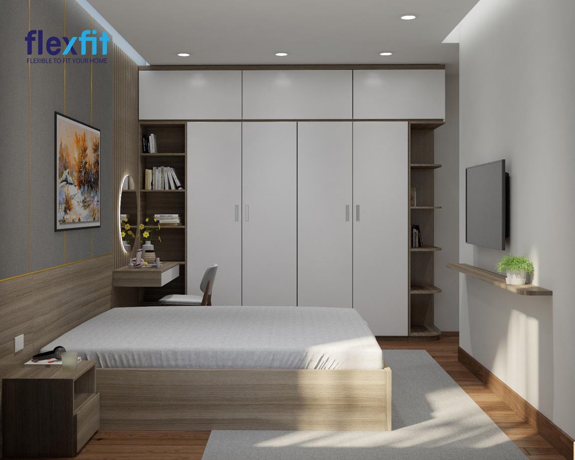 Với phòng ngủ có diện tích vừa, bạn có thể tham khảo mẫu tủ quần áo 4 cánh tích hợp 2 kệ trang trí 2 bên để thay thế cho bức tường đơn điệu. Thiết kế này vừa giúp tối đa sức chứa vừa tăng tính thẩm mỹ cho không gian.