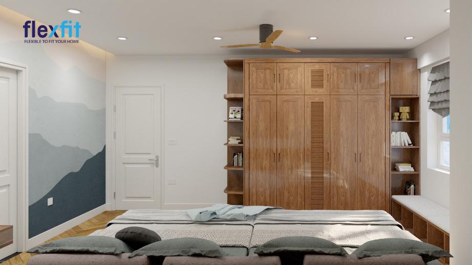 Mẫu tủ 5 cánh này sử dụng chất liệu lõi MDF phủ Melamine bền đẹp dài lâu. Tủ có kích thước 2m8, màu nâu vân gỗ cổ điển, hài hòa với nội thất phòng ngủ. Thiết kế thêm giá sách và kệ trang trí giúp tủ bớt đơn điệu.