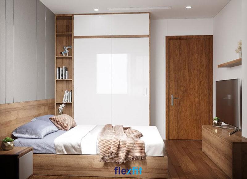 Tủ quần áo lõi MDF phủ Acrylic màu trắng sáng bóng. Bên trái tủ là kệ trang trí nâu vân gỗ mang lại sự mới mẻ hơn cho không gian phòng.