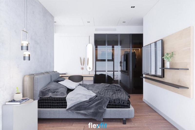 Tuy sử dụng tủ quần áo 2m6 lõi MDF phủ Laminate 4 cánh nhưng phòng ngủ không hề có cảm giác chật hẹp mà còn tạo cảm giác nới rộng không gian nhờ thiết kế cánh kính dạng lùa tiện lợi