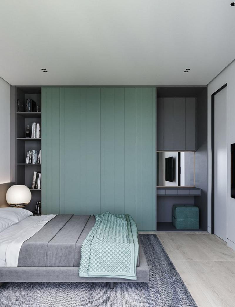 Mẫu tủ quần áo tích hợp bàn trang điểm này sử dụng hai gam màu xanh ngọc và xám đồng điệu với màu sắc chủ đạo của nội thất trong phòng. Tủ có thiết kế thêm kệ trang trí để bạn có thể đặt sách, vật dụng trang trí làm đẹp cho căn phòng.
