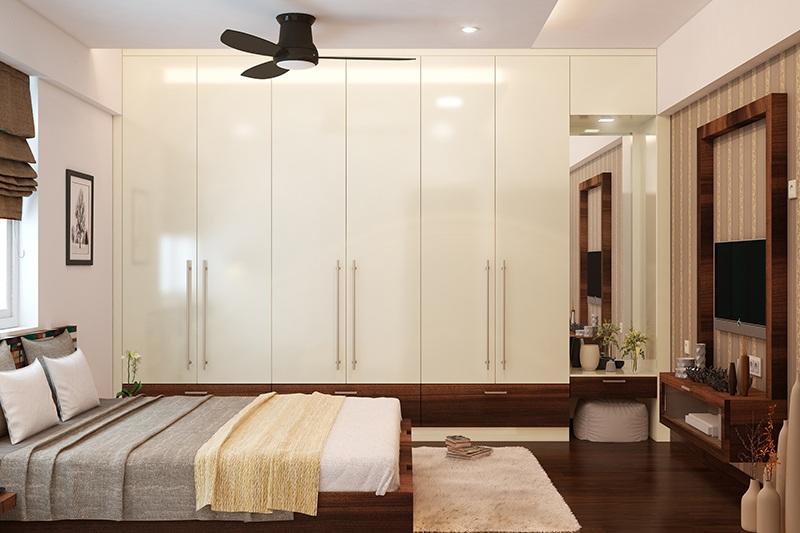 Tủ quần áo kịch trần kết hợp bàn trang điểm phối hai màu trắng và nâu vân gỗ trầm hài hòa màu nội thất trong căn phòng. Vì vậy, không gian phòng vừa mang hơi thở hiện đại, vừa cho cảm giác thoải mái, dễ chịu.