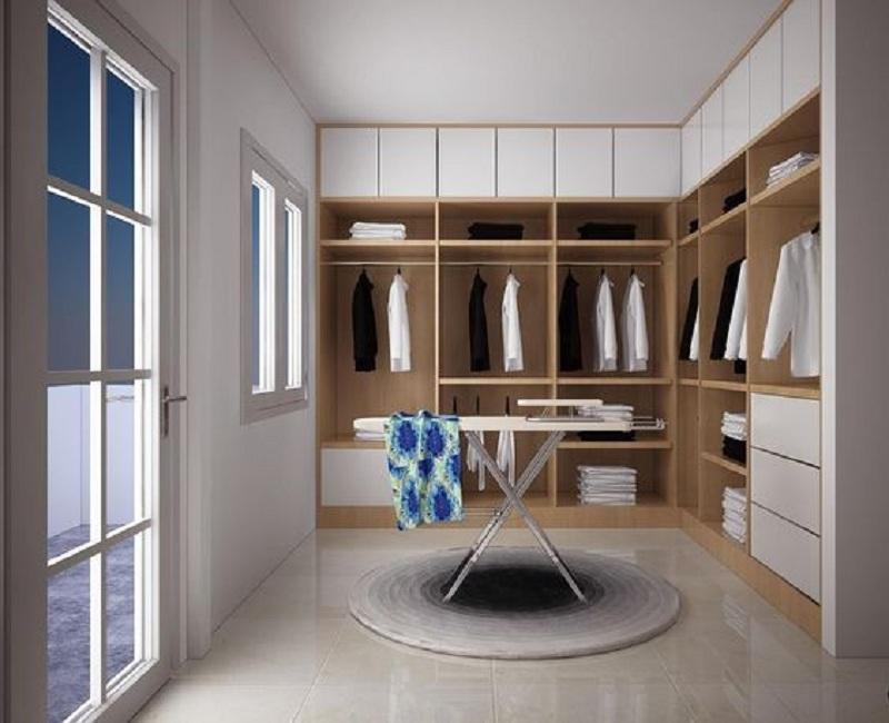 Tủ quần áo không cánh thiết kế kịch trần và theo hình dạng hình chữ L giúp tăng không gian lưu trữ. Đồng thời, căn phòng nhỏ trở nên rộng rãi, thoáng đãng hơn.