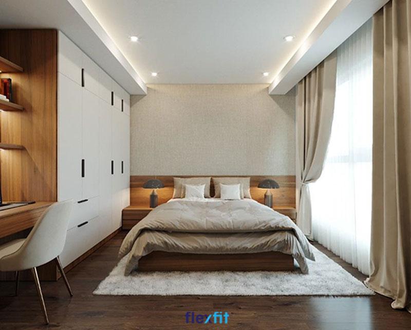 Hệ thống tủ quần áo liền giường lớn trong không gian phòng ngủ rộng rãi, tích hợp nhiều vật dụng tiện lợi như tủ đầu giường và bàn làm việc kèm giá sách.