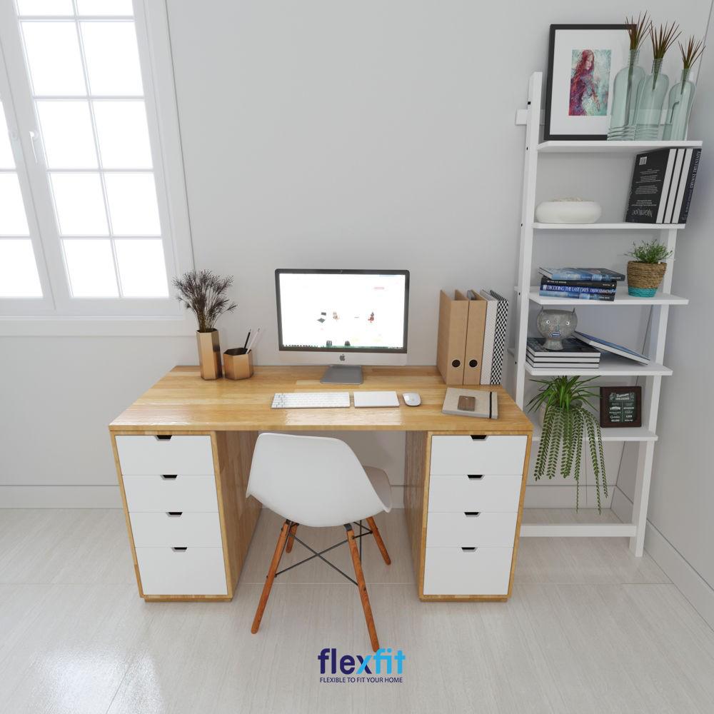 Mẫu bàn làm việc tối giản có thiết kế tiện lợi đa năng với hai chân bàn tích hợp các ngăn tủ. Bàn được làm từ chất liệu gỗ công nghiệp, có màu vân gỗ nhẹ nhàng, kết hợp với màu trắng tạo nên sự hài hòa và mang lại phong cách trẻ trung.