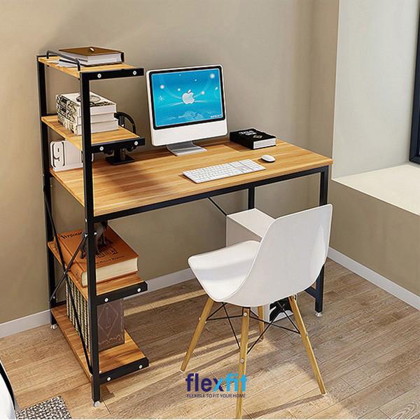 Mẫu bàn làm việc bằng gỗ công nghiệp mang màu sắc Vintage với sự kết hợp màu vân gỗ trầm và các thanh kim loại đen. Giá sách đóng liền với bàn giúp bạn có thể để những cuốn sách hay sử dụng,... lấy ra cất vào tiện lợi.