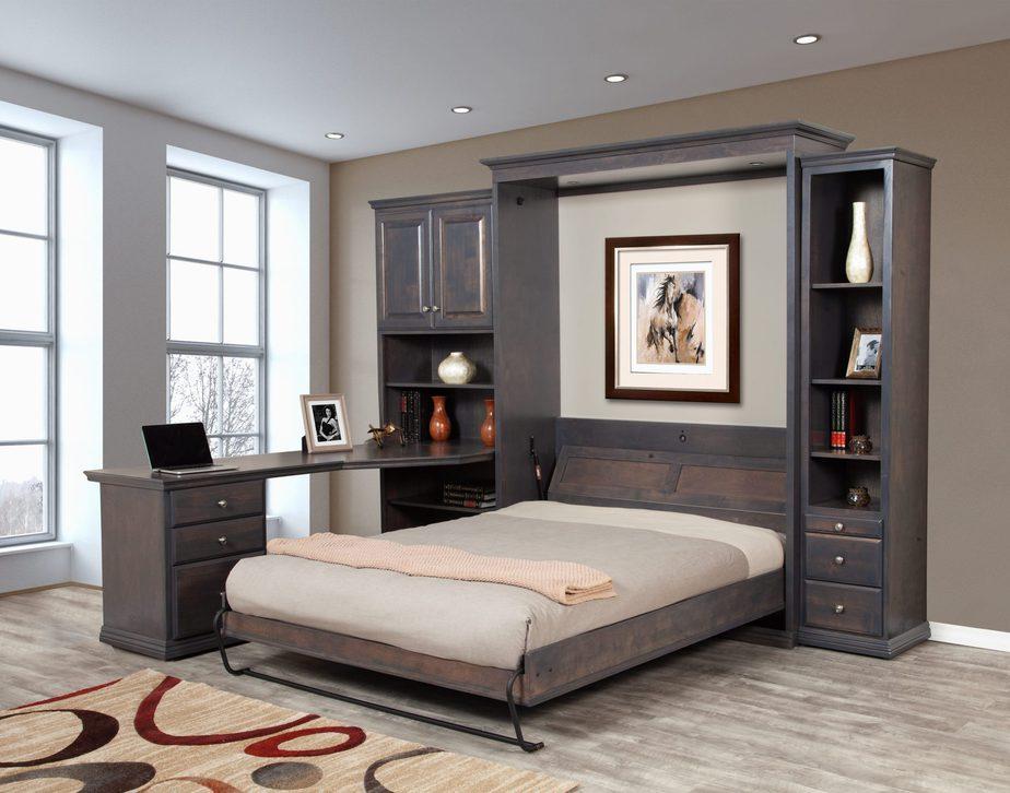 Giường gấp tường thông minh này ngoài kết hợp hệ tủ vừa trang trí, vừa để đồ còn có bàn làm việc liền kề vô cùng hiện đại và tiện nghi. Hệ giường tủ sở hữu gam màu xanh pha nâu vân gỗ trầm ấn tượng, độc đáo.
