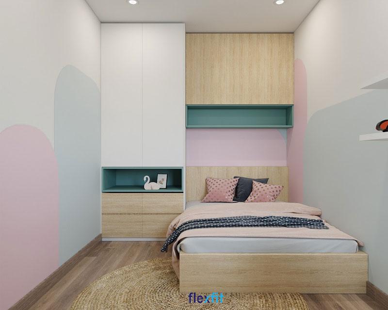 Mẫu giường đơn tích hợp tủ quần áo nhỏ gọn và kệ trang trí đồng bộ về chất liệu gỗ MFC phủ Melamine dễ vệ sinh. Hệ tủ giường màu vân gỗ sáng kết hợp những gam màu tươi sáng như hồng và xanh pastel mang đến không gian tràn sức sống.