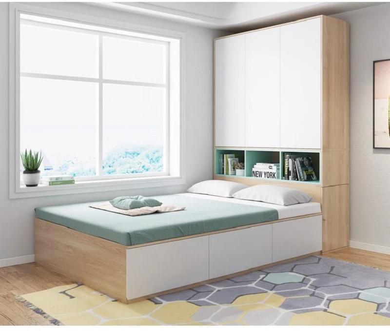Mẫu giường ngủ tích hợp tủ quần áo có các ngăn tủ hở để sách, truyện tranh ngay đầu giường rất thuận tiện cho bạn lấy đọc.