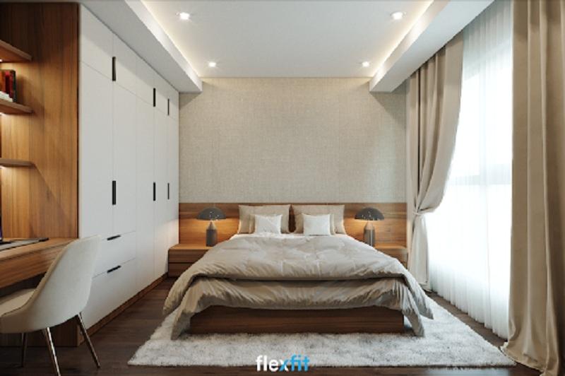 Giường gỗ MFC phủ Melamine màu vân gỗ trầm ấm bền đẹp dung hòa màu trắng lạnh của thảm trải sàn, tủ quần áo. Không gian phòng nhờ đó trở nên ấm áp mà vẫn toát lên sự sang trọng vốn có.