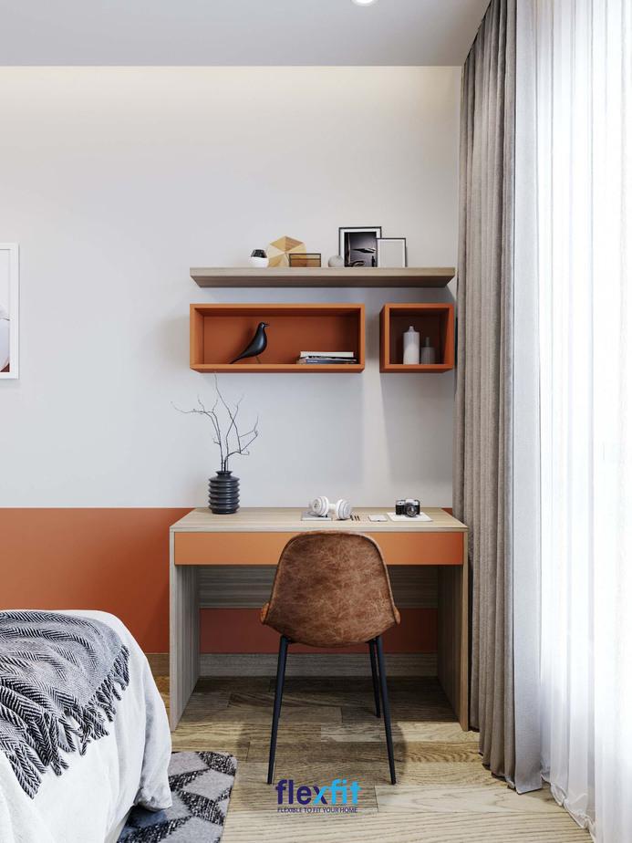 Mẫu bàn làm việc nhỏ gọn kích thước 60cm x 90cm màu cam phối vân gỗ mới lạ, thu hút. Đặc biệt, bàn kết hợp hai ô tủ không cánh trang trí riêng biệt cùng màu cam pastel giúp không gian thêm bắt mắt.