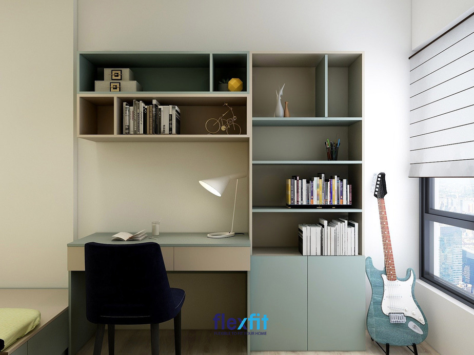 Với thiết kế hiện đại, bàn làm việc gắn liền với tủ đựng sách tạo một khối thống nhất, giúp căn phòng thêm hài hòa. Màu xanh trắng matte toát lên vẻ đẹp nhã nhặn, sang trọng cho căn phòng.