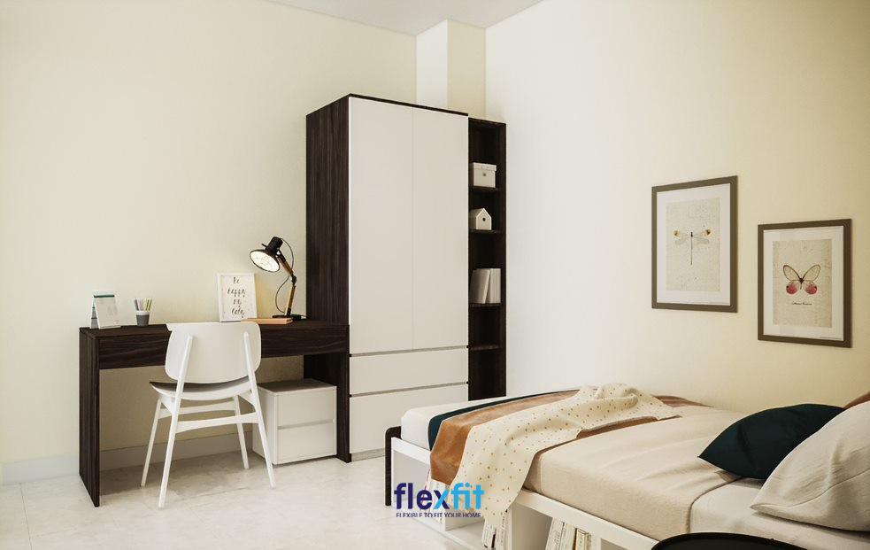 Mẫu bàn làm việc này được thiết kế đơn giản, tích hợp cùng tủ quần áo, phù hợp với căn phòng nhỏ vì chiếm ít diện tích. Bàn được làm từ gỗ MFC phủ Laminate chống ẩm tốt cùng màu vân gỗ óc chó sang trọng.
