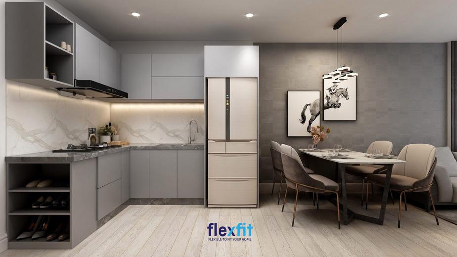 Mẫu tủ bếp lắp ghép chữ L Flexfit thiết kế thi công cho chị Hoàng Anh ở Thanh Xuân - Hà Nội. Sản phẩm làm bằng chất gỗ lõi MDF phủ Melamine chống ẩm kết hợp bàn đá của Vicostone cung cấp vừa dễ vệ sinh, vừa có độ bền cao.