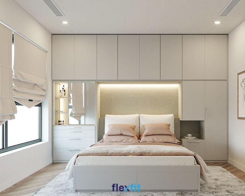 Giường có kích thước 1,4x2m, sử dụng lõi gỗ MFC phủ Melamine trắng sở hữu độ bền màu cao và dễ vệ sinh. Giường được kết nối liền mạch với hệ thống tủ quần áo, bàn trang điểm tiện dụng và giúp tối ưu không gian phòng.