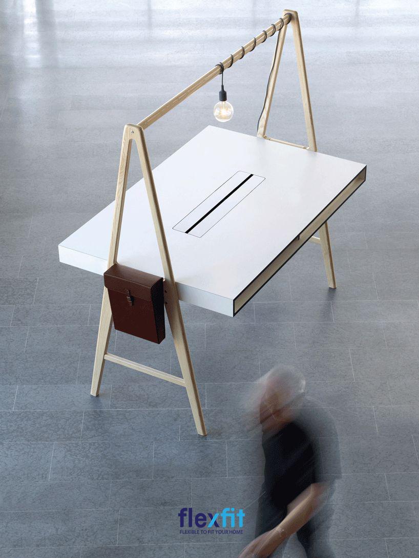 Mẫu bàn này được lấy cảm hứng từ những chiếc nôi với thiết kế hai chân chữ A giúp bàn đứng vững ở mọi mặt phẳng. Chân trụ giúp cố định giá treo để treo đèn làm việc giúp ánh sáng tập trung được vào phần trung tâm của bàn.