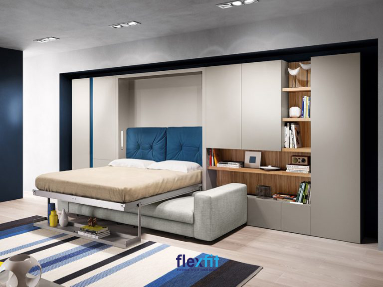 Mẫu giường âm tường đa dụng với chân kéo đẩy giường có thể tận dụng để đồ. Khi không sử dụng bạn chỉ cần gấp gọn giường lại là có ngay không gian thư giãn với ghế sofa.