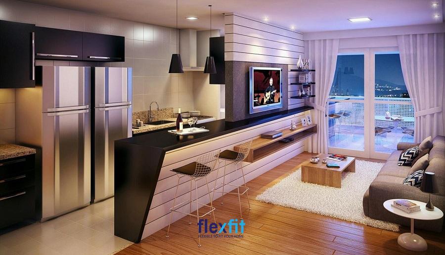 Một cách đơn giản để phân chia phòng khách với bếp nhưng cực kỳ hợp lý đó chính là sử dụng quầy bar