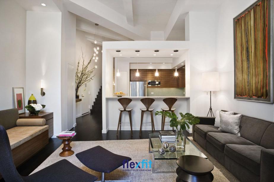 Ý tưởng thiết kế quầy bar ngăn với phòng khách mang đến cho không gian sự mới mẻ, cá tính và phân chia rõ các khu chức năng khéo léo
