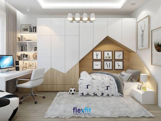 Căn phòng trở nên độc đáo nhờ việc tích hợp khéo léo không gian nghỉ ngơi với tủ quần áo, vừa tiết kiệm diện tích vừa trở thành nơi thỏa sức trang trí, sáng tạo