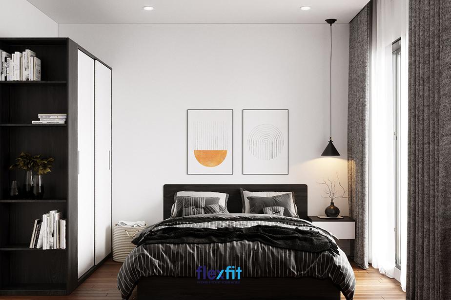 Phòng ngủ sử dụng 2 mảng màu đối lập tạo nên điểm nhấn nổi bật, giúp căn phòng tuy đơn giản nhưng vô cùng hút mắt.