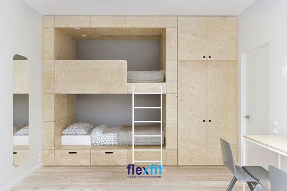 Chiếc giường tầng với màu gỗ sáng tự nhiên liền tủ giúp không gian phòng ngủ trở nên tiện nghi và thuận tiện nhất cho bé khi sử dụng.