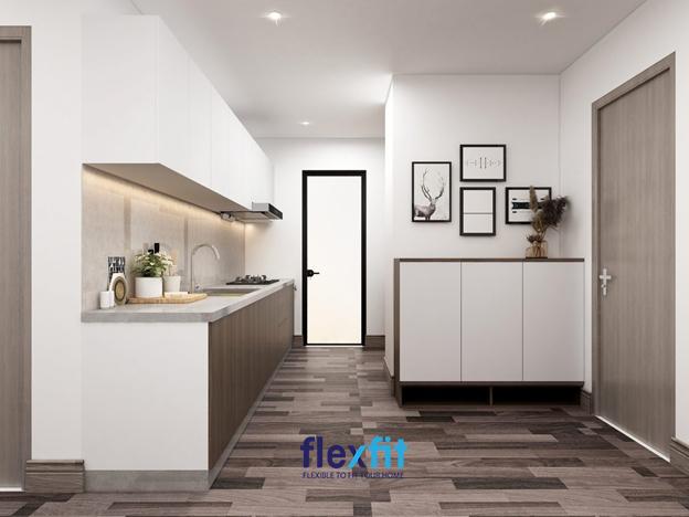 """Mẫu tủ kích thước 4m2 siêu nhỏ gọn này là lựa chọn lý tưởng cho căn bếp có diện tích """"khiêm tốn"""". Với chất liệu lõi MDF chống ẩm, bề mặt Melamine kết hợp giữa hai màu trắng và vân gỗ tạo sự hài hòa giữa sàn gỗ và màu sơn tường. Các hộc tủ thiết kế đều nhau, có cánh tạo sự đồng nhất cho nhà bếp."""