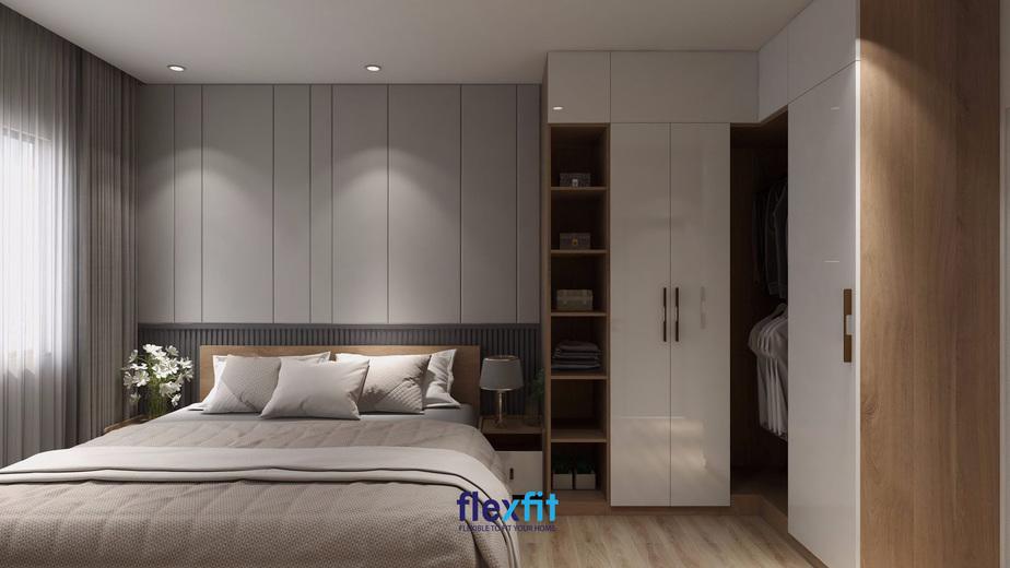 Màu ghi được chọn là tông màu chủ đạo cho căn phòng giúp không gian phòng ngủ trở nên thanh lịch, sang trọng. Với hệ thống tủ chữ L được bố trí sát tường giúp nới rộng diện tích căn phòng một cách hiệu quả.