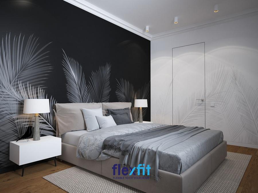 Một mảng tường màu đen kết hợp họa tiết vẽ lá cây làm căn phòng vừa cuốn hút, vừa độc đáo