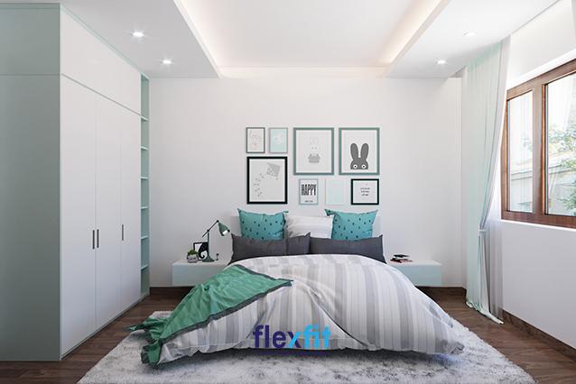 Không gian phòng ngủ trang trí tranh ảnh màu xanh lá phù hợp với gia chủ mệnh Hỏa.