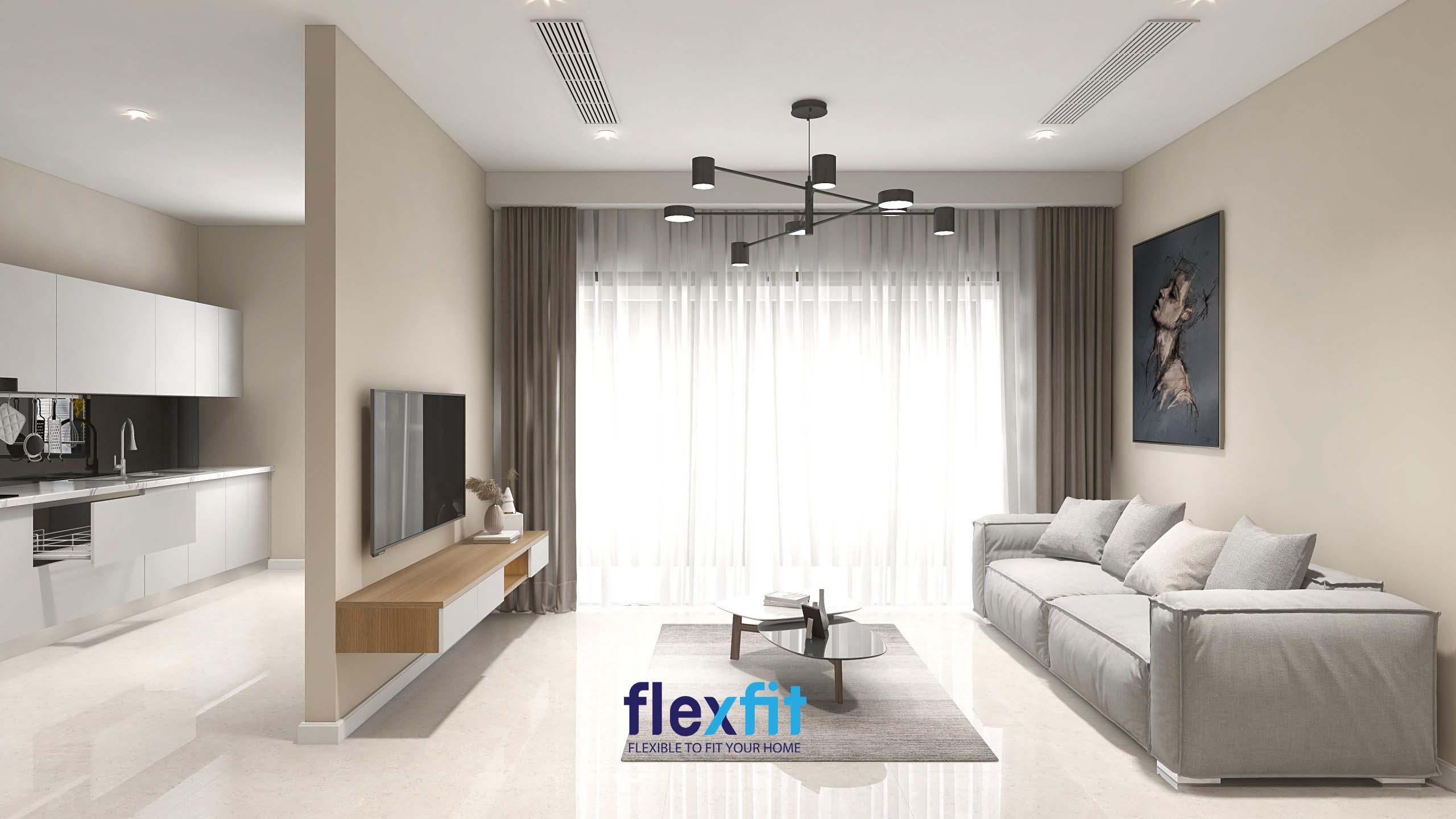 Vách ngăn tường bê tông kiên cố, màu be nhã nhặn dùng để ngăn cách phòng khách, phòng bếp; giảm bớt hỏa khí và gắn tivi, ngăn tủ tăng thêm tính tiện ích cho không gian