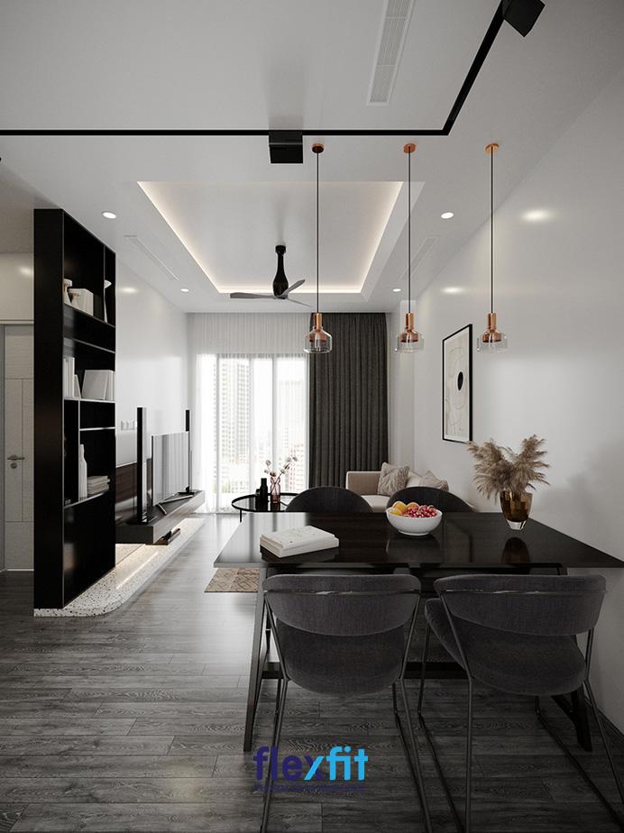 Kệ trang trí bằng gỗ sơn đen sẽ là điểm nhấn sang trọng và nổi bật để ngăn cách phòng khách và không gian hành lang, giúp ngăn chặn luồng khí xấu từ bên ngoài vào