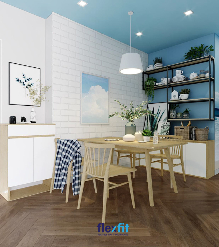 Xanh lam nhẹ nhàng cùng nội thất gỗ khiến không gian phòng bếp mệnh Thủy hài hòa hơn.